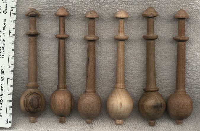 eight wooden bobbins after the style of those found on the Batavia